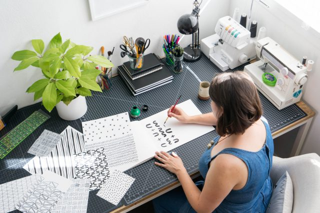 Erin Dollar drawing patterns in her studio - Cotton & Flax