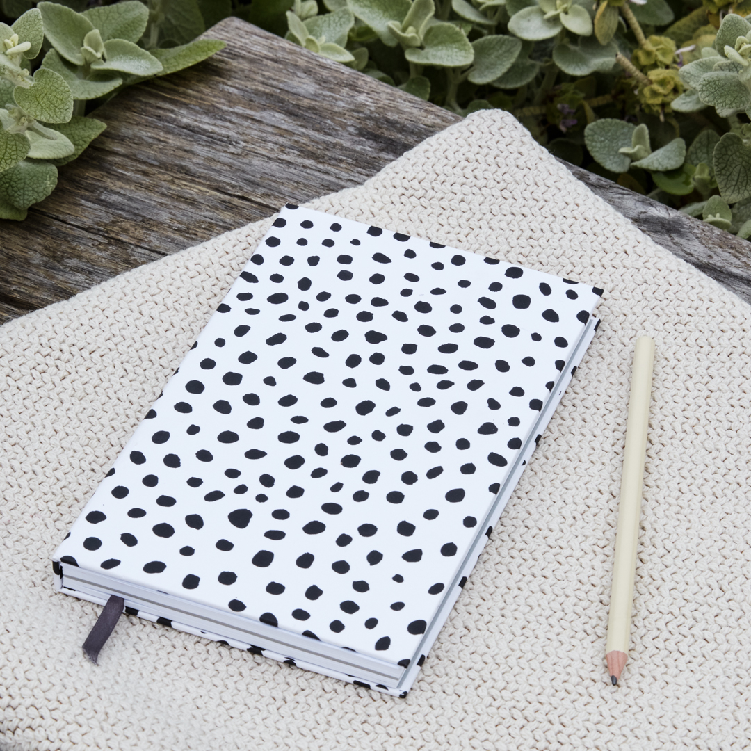 Black and white dotted notebook